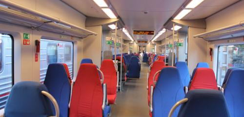 Economy class car interior of high-speed train Lastochka