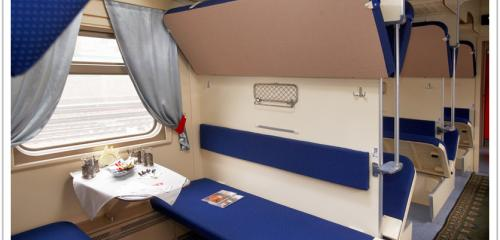 3d class compartment features with folding upper bunk beds and table