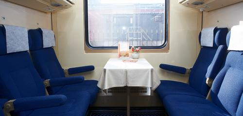 Nevsky Express train features 3 + 3 seats facing each with a table in between