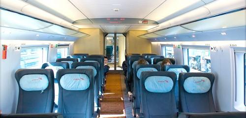 Economy class car interior of high-speed train Sapsan